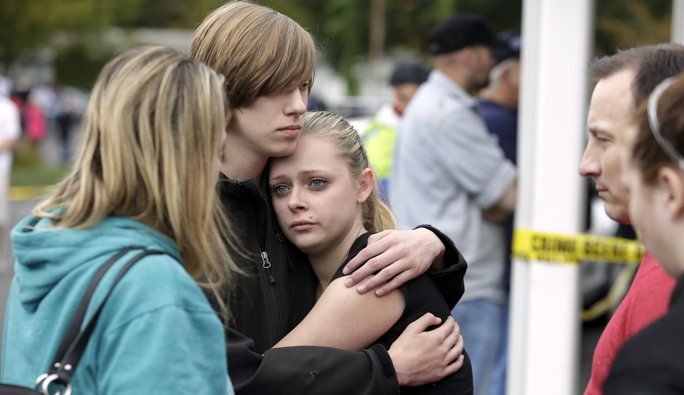Students and family members reunite at Shoultes Gospel Hall after a student opened fire at Marysville-Pilchuck High School in Marysville, Washington